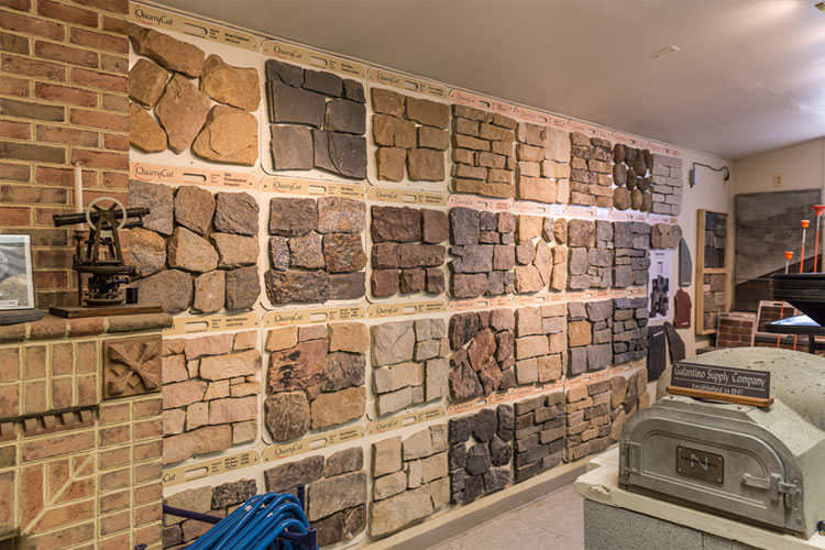A wall showcasing different kinds of brick veneer, thin stone patterns that make things look like actual stone walls.